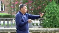 Senior Asian man practicing tai chi in the park video