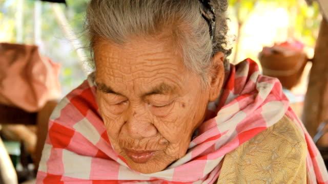 senior asian woman angry at camera. video