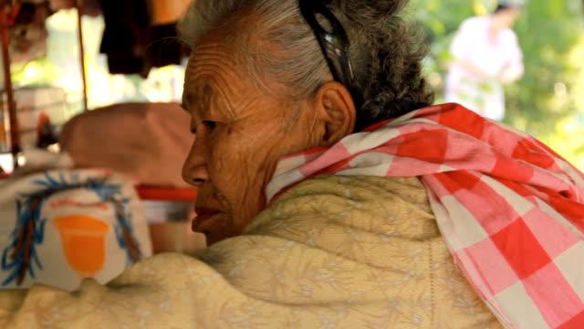 senior asian woman angry. video