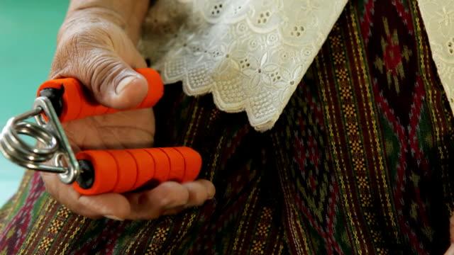 Senior asian woman exercise sport hand grip equipment video