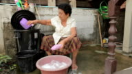 Senior asian woman washing cloths by hand video