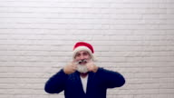 senior beard man showing copy space  in hat santa claus video