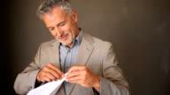 Senior business man throwing a paper plane video
