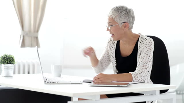 Senior business woman with allergy video