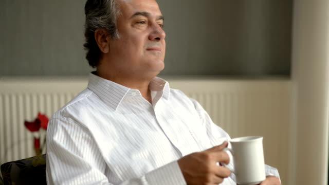 DOLLY: Senior businessman contemplating video