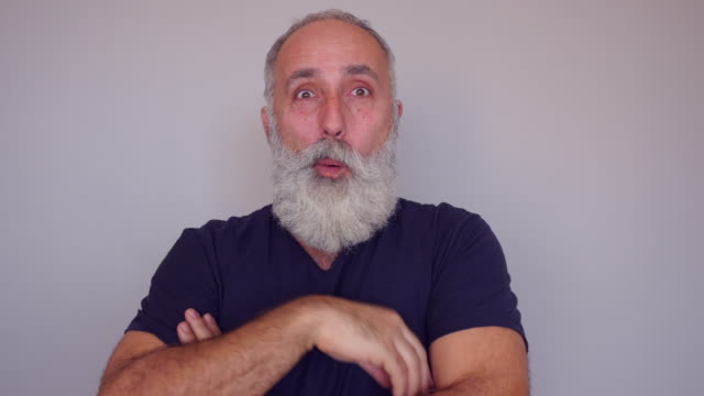 A senior Caucasian bearded man comes up with a splendid idea video
