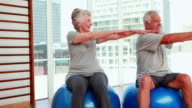 Senior citizens working out video