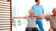 Senior citizens working out with physiotherapist video