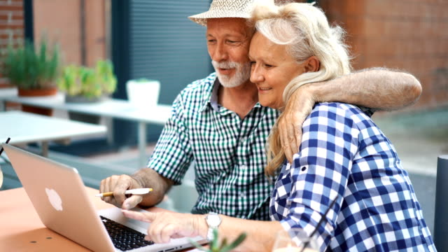 Senior couple at a sidewalk cafe. video