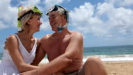 Senior couple at beach with snorkel gear video