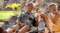 Senior couple at tropical resort video