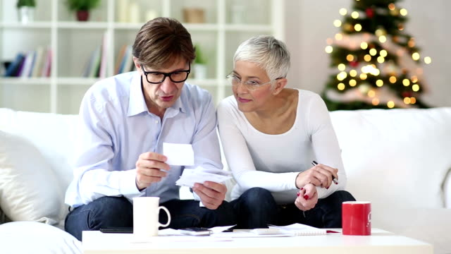 senior couple calculating domestic bills video