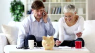 senior couple calculating domestic bills video