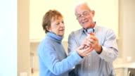 Senior couple discussing prescription medicine video