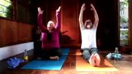 Senior couple doing yoga prayer pose video