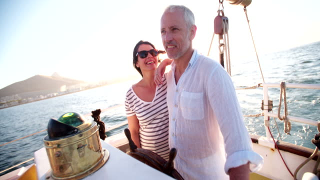 Senior couple enjoying a yacht cruise together video