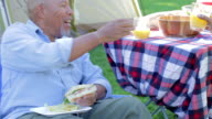 Senior Couple Enjoying Camping Holiday In Countryside video
