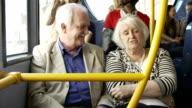 Senior Couple Enjoying Journey On Bus video