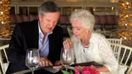 Senior Couple Enjoying Meal In Restaurant video