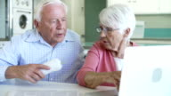 Senior Couple Finding Phone Number Of Company Online video