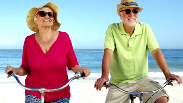 Senior couple going for a bike ride video