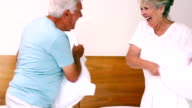 Senior couple having a pillow fight video