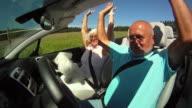 SLO MO Senior Couple Having A Ride video