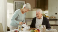Senior couple having breakfast video
