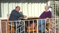 Senior couple having coffee on front porch video