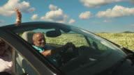 SLO MO Senior Couple In A Convertible video