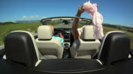 HD SLOW-MOTION: Senior Couple In A Convertible video