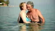 Senior couple in the sea video