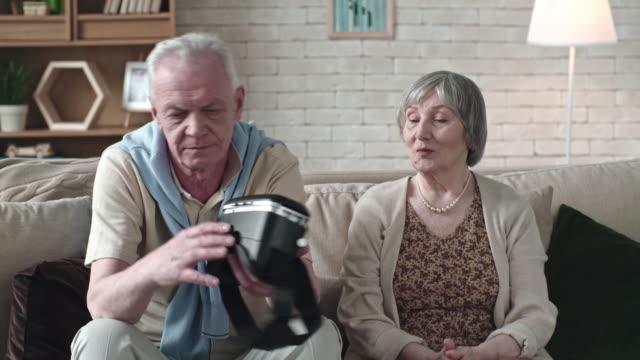 Senior Couple Inspecting VR Headset video