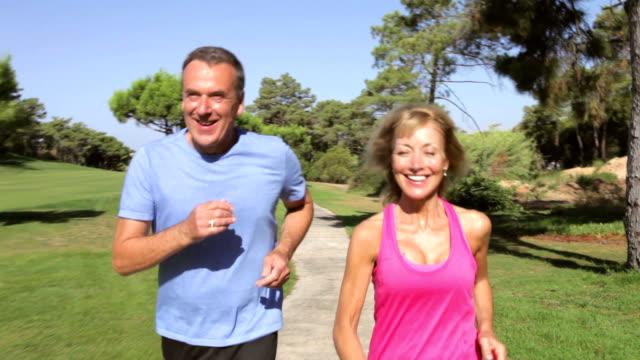 Senior Couple Jogging In Park video