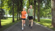 SLO MO TS Senior couple jogging in the park video