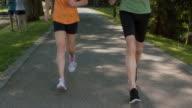 SLO MO TS TU Senior couple jogging through the park video