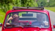 Senior couple kissing in an old zastava car video