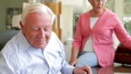 Senior Couple Looking At Picture In Frame And Photo Album video