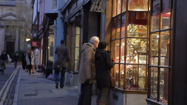 Senior Couple Looking In Antique Shop Window At Dusk video