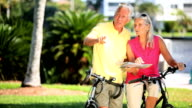 Senior Couple Mapping a Cycling trip video