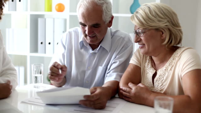 Senior Couple Meeting With Financial Advisor. video