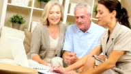 Senior Couple Meeting with Financial Advisor video