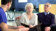 Senior Couple Meeting With Surgeon In Hospital video