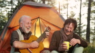 Senior couple play guitar video
