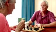 Senior couple playing chess video