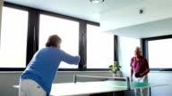 Senior couple playing table tennis video