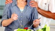 Senior couple preparing a healthy salad together video