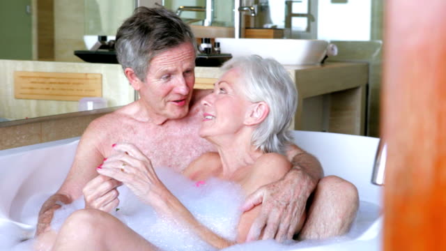 Senior Couple Relaxing In Bath Together video