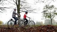 Senior couple riding their bikes video