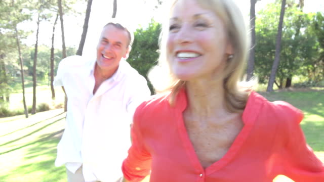 Senior Couple Running Along Country Path Together video